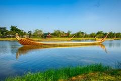 Replicas of the royal barges at Muang Boran (Ancient City) in Samut Phrakan near Bangkok, Thailand (UweBKK (α 77 on )) Tags: sony alpha 550 dslr thailand southeast asia bangkok samutphrakan samut phrakan muangboran muang boran ancient siam city outdoors open air museum park garden replica royal barge boat ship water lake reflection