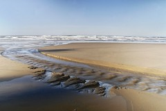 Water and Sand (Mary Ann Whitney-Hall) Tags: oregoncoast water sand carvings ripples creek stream pacific ocean hugpoint waves sky flow change pools reflections blues tans browns shadows