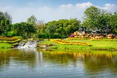 Lake and the Garden of Gods in Muang Boran (Ancient City) in Samut Phrakan near Bangkok, Thailand (UweBKK (α 77 on )) Tags: sony alpha 550 dslr thailand southeast asia bangkok samutphrakan samut phrakan muangboran muang boran ancient siam city outdoors open air museum park garden lake water reflection tree bush gardenofgods gods