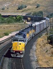 The Milk Cans (jamesbelmont) Tags: unionpacific webercanyon peterson utah emd sd60m sd402 evanstonsub automobiles milkcans mlkcns train railroad railway locomotive