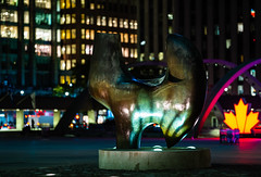 Three-Way Piece No. 2 - The Archer (RoTTeN aPPLe WaYFaReR) Tags: toronto ontario canada sonyphotographing sony mirrorless sonya7riii sonyilce7rm3 fe135mmf18gm publicart outside art night bokeh