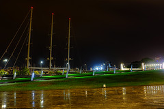 Solitude: The Port, the rain & me (Fnikos) Tags: parc park parque parco port porto puerto harbour harbor waterfront rain color colour colores colours colors green grass shadow shadows reflections boat sailboat ship sky cielo building architecture night nightview nightshot outside outdoor