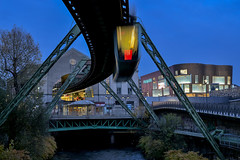 the old and the new... (Blende1.8) Tags: schwebebahn wuppertal wuppertalerschwebebahn bluehour suspensionrailway blauestunde city cityscape bergischesland wupper river fluss brücke lights lichter abends abend evening stadtlandschaft döppersberg elberfeld wuppertalelberfeld nikon nikonz z6 50mm