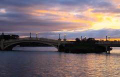 Sunset over the lake (jmiller35) Tags: sunset colours lake water still bridge streetlight sky sunsetsky liverpool merseyside canon tranquil restful