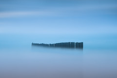 Isolated .... Cap-Ferret ( France ) (Yannick Lefevre) Tags: europe france pyrénéesatlantiques gironde capferret woodpillars minimalist blue longexposure seascape landscape afternoon storm isolated perspective nikon nikkor ndfilter nd400 shore coast