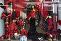 In the Land of Flamenco (cookedphotos) Tags: travel spain granada streetphotography canon 5dmarkiv store window flamenco costume women fashion culture red black