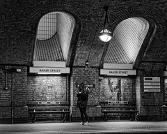 Winding your way... (Croydon Clicker) Tags: blackwhite whiteblack bw monochrome station underground tube platform sign girl passenger lights vents seats bakerstreet london nikon nikkor af28105d