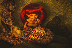 a fairy and her sprinkles (Dotsy McCurly) Tags: smileonsaturday sprinkles hsos happysmileonsaturday candy little fairy cute frog elf elves cave rocks grass nonpareils chocolate canoneos80d efs35mmf28macroisstm