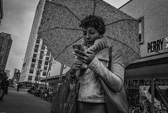 RotterdamUmbrella (Peter M. Meijer) Tags: rotterdam holland street strada strasse callejera straat ricohgrii wideangle candid closeup people man woman bw bn city urban 201911 november