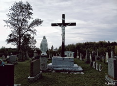... (Jean S..) Tags: cemetery graves graveyard statue cross sky tree clouds grass