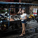Thai Girl buying lunch at a Foodcart
