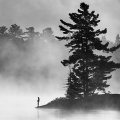 Gone Fishing Grundy - 3361 (RG Rutkay) Tags: grundytrip nature nearnorth outdoors abstract silhouette bw wilderness lake trees person fishing mist fog dawn earlymorning telephoto monochromatic tranquility calm peaceful