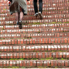 a man and a woman (vertblu) Tags: staircase stairs stairway people man woman stepup brickwork bricks grass goingupstairs bsquare 500x500 kwadrat red white bakestones vertblu urban hamburgaltona sliceoflife cityscene graphic graphical