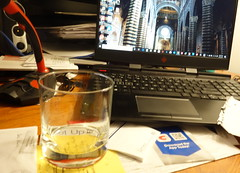 A real desktop (neil.gilmour) Tags: desktop computer monitor wood glass microphone drink whiskey duomo chathedral sienna tuscany italy