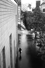 In front of the theater (pascalcolin1) Tags: paris13 femme woman pluie rain reflets reflection theater théâtre photoderue streetview urbanarte noiretblanc blackandwhite photopascalcolin 50mm canon50mm canon