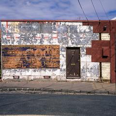 Seddon (Westographer) Tags: seddon melbourne australia westernsuburbs suburbia patina weathered distressed textures typography fadedsign fauxbrickcladding door film fujivelvia transparency square 6x6 layers cladding mediumformat