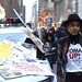NYC Women's March Protest- Young Woman in front of NYPD Car Covered in Protest Signs