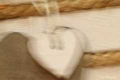 Love in motion... (Maria Godfrida) Tags: smileonsaturday motionblur loveinmotion heart blurred rope closeup white object