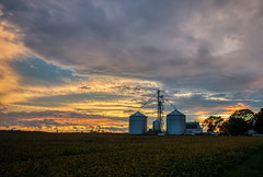 Watching the Sky - 6:52 (tquist24) Tags: hdr indiana nikon nikond5300 outdoor clouds color evening farm field geotagged grainsilo landscape outside rural sky soybeans sunset tree trees