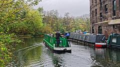Regents Canal (Croydon Clicker) Tags: canal boat barge water reflection building warehouse trees autumn man person london kingscross coaldropyard regentscanal nikon nikkor nikkoraf28105d nikond700
