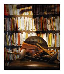 weapons & books (Armin Fuchs) Tags: arminfuchs lavillelaplusdangereuse 6x7 weapons sword books shadows grain holes leather 40mm pancake