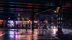 rainy night under the el (onefivefour) Tags: nyc newyork astoria 30thave rain night dark reflections queens el crosswalk wet