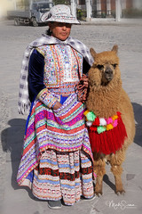 Woman with a lama II (marko.erman) Tags: colca valley river yanque village folk traditional tradition dressing bridal parades portrait colorfull sony outside sunny peru clothes hat decorated embroidery lama animal latinamerica southamerica