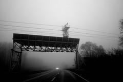 Gate to no one's land (stefankamert) Tags: gate fog street car road grain noiretblanc noir stefankamert ricoh gr griii ricohgriii 28mm bw wideangle landscape lines mood light