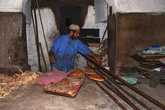 Baker in Fez (JLM62380) Tags: baker work worker artisan boulanger travailleur fez fes pain bread four oven morocco maroc africa afrique feudebois woodfire