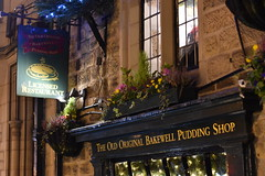 The Old Original Bakewell Pudding Shop (CoasterMadMatt) Tags: bakewell2019 bakewell village villages town towns englishvillages villagesinengland honeypotvillage honeypottown markettown markettowns bakewellatnight illuminated illumination lights litup inthedark nighttimephotography theoldoriginalbakewellpuddingshop oldoriginalbakewellpuddingshop bakewellpuddingshop old original pudding shop bakery building structure architecture derbyshiredales derbyshire dales derbys eastmidlands englishmidlands themidlands midlands england britain greatbritain gb unitedkingdom uk europe november2019 autumn2019 november autumn 2019 coastermadmattphotography coastermadmatt photos photography photographs nikond3500