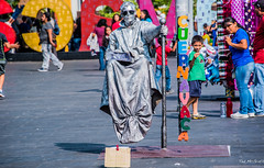 2019 - Mexico - Cuernavaca - 12 - Zócalo Busker (Ted's photos - Returns Early February) Tags: 2019 cuernavaca mexico nikon nikond750 nikonfx tedmcgrath tedsphotos tedsphotosmexico vignetting costume shadows zócalo zocalo cuernavacamorelos morelos cuernavacazocalo den denimjeans sunglasses sign redrule red pose posing
