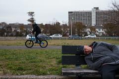 Dozing (dtanist) Tags: nyc newyork newyorkcity new york city sony a7 contax zeiss carlzeiss carl planar 45mm bath beach shore promenade napping nap sleeping bench man dozing bicycle bicyclist cyclist bike