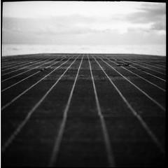 Last Lights (Manuel&TheSea) Tags: monochrome mediumformat medium filmphotography ishootfilm tlr analoguephotography analogue bw iso125 homedevelop rodinal125 rodinal ilfordfilm ilford fp4 ilfordfp4 somberthiotparis luxoflex atos2 6x6 squareformat vintagecamera 50scamera lines jetty iron dof