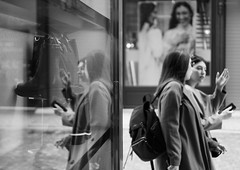 Catching up... (Michael Kalognomos) Tags: sonya6400 streetstories streetphotography streetlife photography mirror reflection women girls blackandwhite bw bokeh depthoffield sony35mmf sony35mmf18oss athens greece