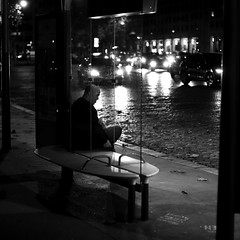 In front of the car headlamps (pascalcolin1) Tags: paris13 homme man nuit night lumière light voitures cars headlamps phares route road banc bench photoderue streetview urbanarte noiretblanc blackandwhite photopascalcolin 50mm canon50mm canon