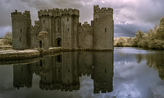 The castle in the lake (David Feuerhelm) Tags: bodiam sussex castle building towers moat water reflections mirror wideangle infrared ir falsecolour nikkor 18200mmf3556 nikon d90