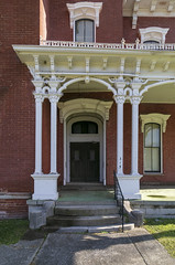 Porch and Door, James Walker House — Richmond, Kentucky (Pythaglio) Tags: house dwelling residence historic vacant dilapidated ornate italianate twostory brick cornice brackets segmentalarched hoodmolds porch scrollwork chimneys jameswalker nrhp nationalregister 83003789 1870s