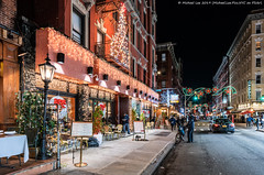 Mulberry Street (20191122-DSC09959) (Michael.Lee.Pics.NYC) Tags: newyork mulberrystreet littleitaly night street storefront christmas holiday lights decorations architecture cityscape sony a7rm4 zeissloxia21mmf28