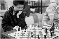 Difficult Game - Library XT8475e (Harris Hui (in search of light)) Tags: canada vancouver fuji bc richmond fujifilm fixedlens standardlens xt1 fujix mirrorless harrishui vancouverdslrshooter fujixseries digitalmirrorlesscamera fujixcamera fujixt1 fujixambassador fujiprimelens fujixf35mmf2 bw blackwhite street streetcandid streetphotography library downtownvancouver monochrome chess chessplayer chessgame hongkongdistrictcouncilelection hongkongprodemocracymovement hongkong hongkongprotest difficultgame thinking whatwillbethenextmove