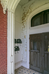 Entry Detail, James Walker House — Richmond, Kentucky (Pythaglio) Tags: house dwelling residence historic vacant dilapidated ornate italianate twostory brick cornice brackets segmentalarched hoodmolds porch scrollwork chimneys jameswalker nrhp nationalregister 83003789 1870s