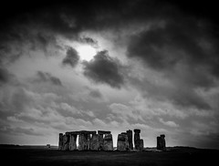 Stone Henge through the clouds (broadswordcallingdannyboy) Tags: stonehenge england neolithic stones stonecircle salisbury wiltshire eos7d eflens leonreillyphotography donotcopy copyright mood atmosphere bw mono dramaticsky heritage 5000bc uk landmark ancient prehistoric englishheritage contrast amesbury light shadows iconic