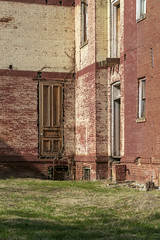 Rear Doors, James Walker House — Richmond, Kentucky (Pythaglio) Tags: house dwelling residence historic vacant dilapidated ornate italianate twostory brick cornice brackets segmentalarched hoodmolds porch scrollwork chimneys jameswalker nrhp nationalregister 83003789 1870s