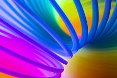 Neon Slinky Clone (adamopal) Tags: canon canon7d canon7dmkii canon7dmarkii neonslinkyclone neonslinky slinkyclone slinky clone knockoff spring springy spiral macro macro100mm 100mm uv ultraviolet neon neoncolors uvlight ultravioletlight pink purple magneta blue cyan green orange yellow