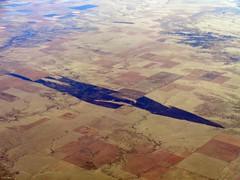 Two Buttes Reservoir and Windpower (zeesstof) Tags: aerial aerialview businesstrip commercial commercialflight flight geo:lat=3794395292 geo:lon=10245920105 geotagged houstontodenver iahtoden triptodenver unitedairlines viewfromwindow zeesstof
