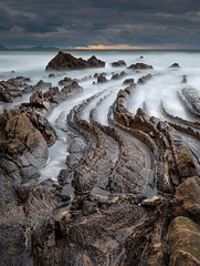 Buried saw (Jerzy Orzechowski) Tags: rock beach landscape sunset water sea spain brown erosion bizkaia waves