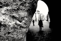 Black Gate (stefankamert) Tags: street ricoh griii gr blur people noiretblanc noir stefankamert 28mm wall textures blackandwhite blackwhite bw underpass