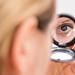 Girl making eye contact through a pocket mirror