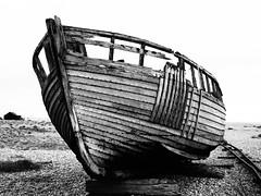 Fishing boat, Dungeness (john Truman) Tags: ancient bw monochrome bleak kent olympus omd em10 mirrorless 25mm m43 f18 fishing boat abandoned beach