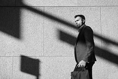Hard Worker (johnjackson808) Tags: shadows vancouver monochrome business wall people fujifilmxt3 bw sun eye blackandwhite streetphotography downtown
