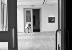 At the museum (peer.heesterbeek) Tags: museum denbosch blackwhite monochrome man sitting reading art